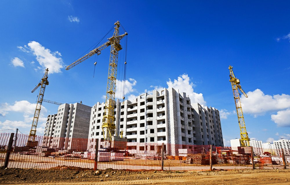 condominium of buildings under construction on a sunny day
